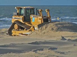 Zand storten in zee tegen stijgende zeespiegel
