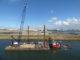 Kobelco cke2500g of marine contractor artes depret on barge in zeebrugge belgium 80x60